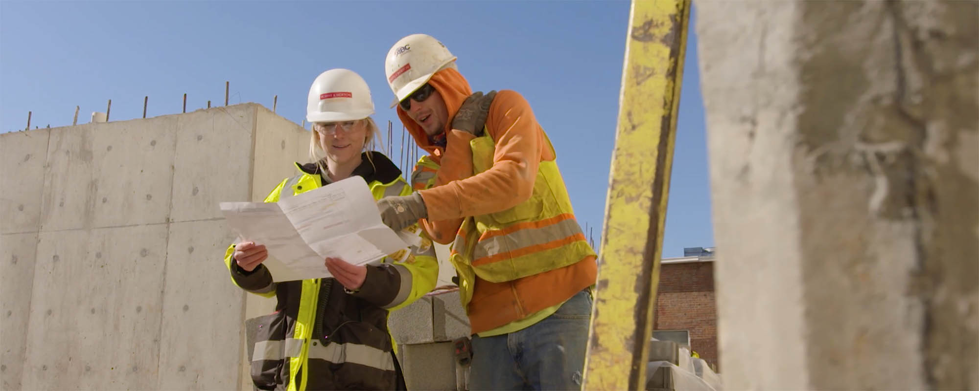 construction workers reading drawings