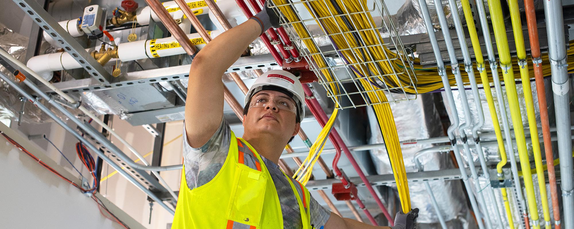 Man installing overhead conduit