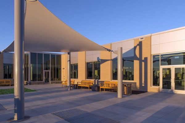 Patio with benches and canopy outside the National Intrepid Center of Excellence facility in Fort Hood