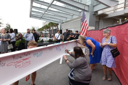 people signing a beam