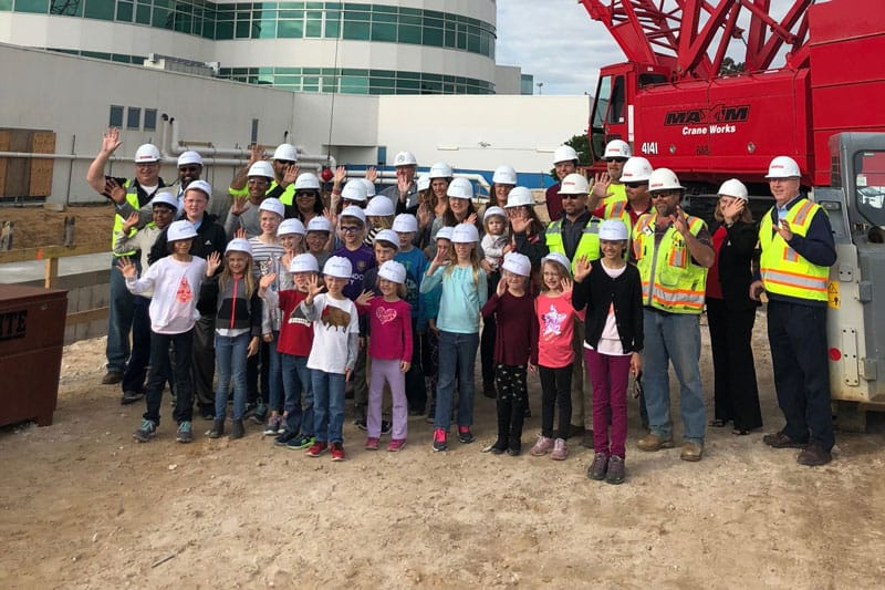 School field trip touring a Robins and Morton construction site