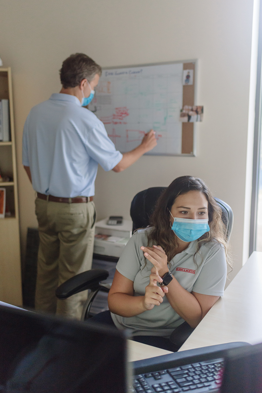 two people working in an office