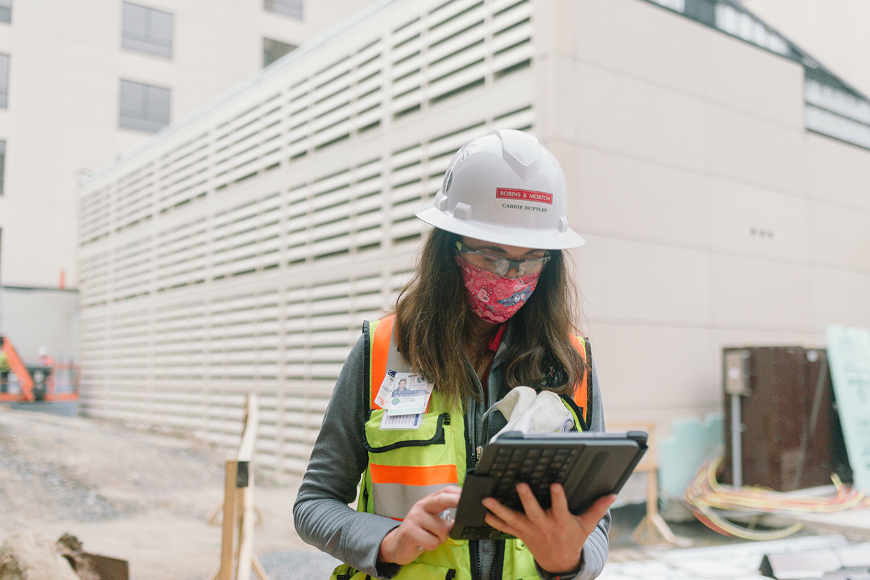construction worker reviewing plans on her iPad
