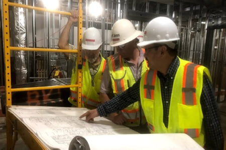 construction workers reviewing plans
