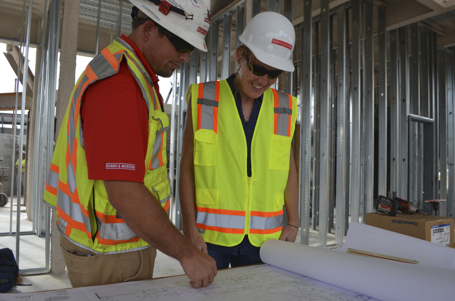 construction workers reading plans