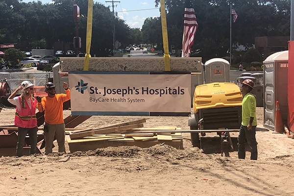 Robins & Morton, St. Joseph's Hospital celebrate expansion topping out