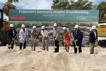 people breaking ground on a hospital