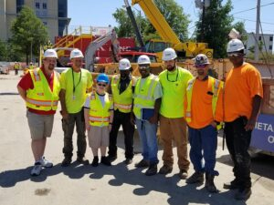 construction workers with child