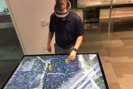man using headset to navigate construction model