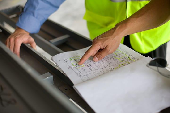contractors assessing blueprint designs