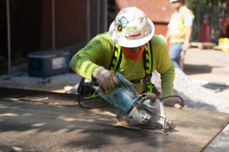 construction worker sawing