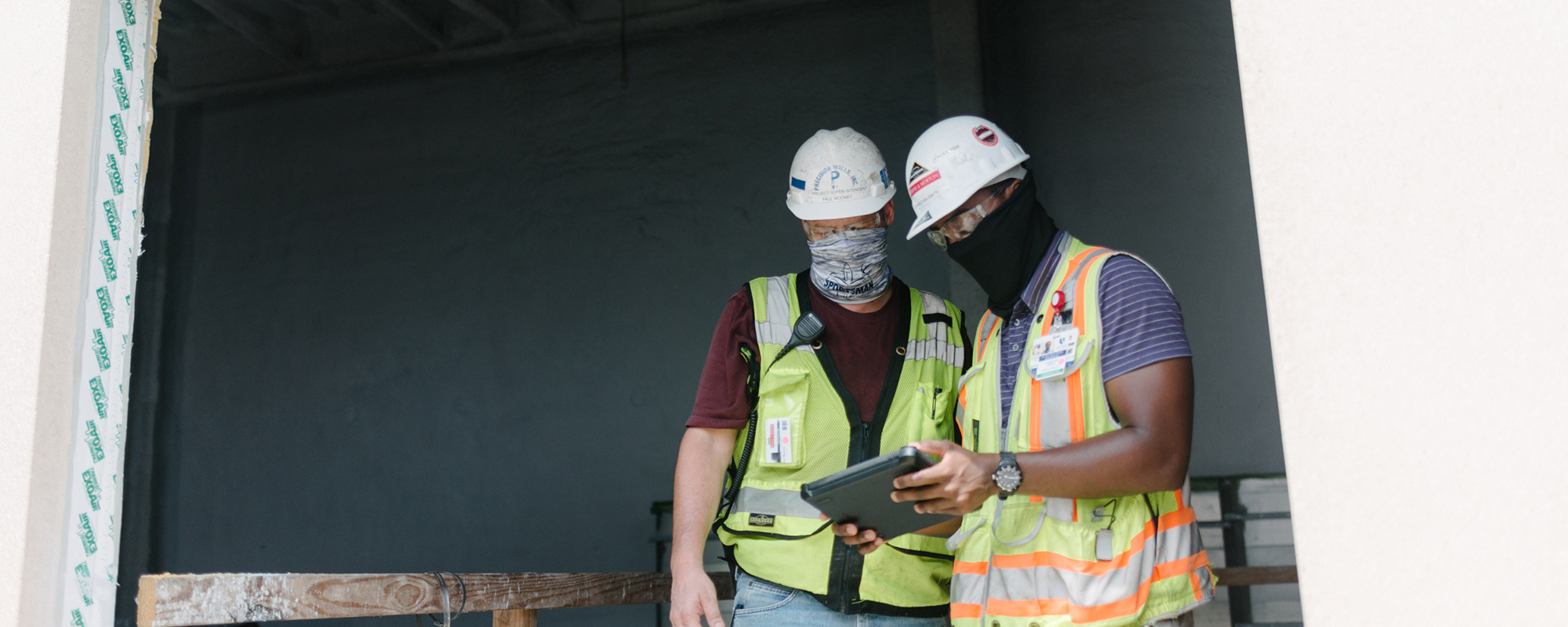 construction workers looking at an ipad